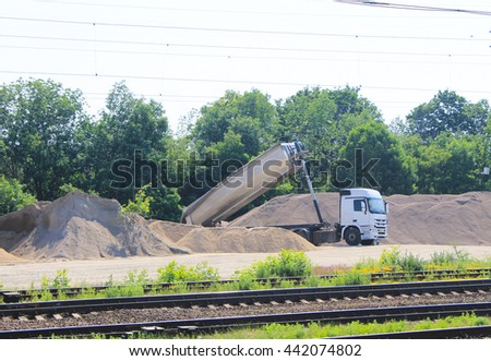 Tipper truck unload gravel - stock photo