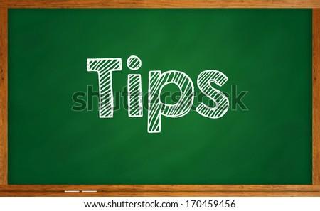 Tips on chalkboard - stock photo