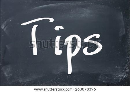 tips word write on blackboard - stock photo