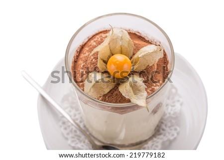 Tiramisu dessert garnished with physalis isolated on white background. Close up - stock photo