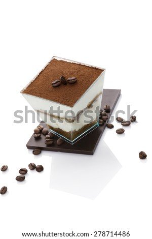 Tiramisu dessert on chocolate bar with coffee beans isolated on white background. Italian sweet dessert concept. - stock photo