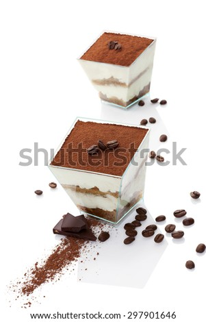 Tiramisu dessert on chocolate bar with coffee beans isolated on white background. Italian sweet dessert concept.