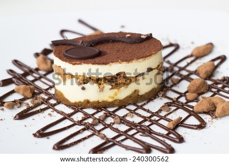 tiramisu dessert with chocolate and almond decoration - stock photo