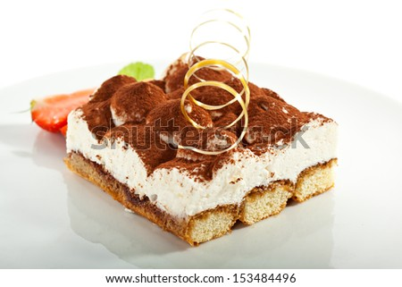 Tiramisu Dessert with Cinnamon and Coffee. Garnished with Strawberry and Mint