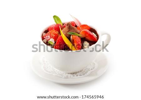 Tiramisu Dessert with Cinnamon and Coffee. Garnished with Strawberry and Mint - stock photo