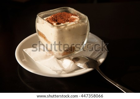 tiramisu in a glass  on black background - stock photo