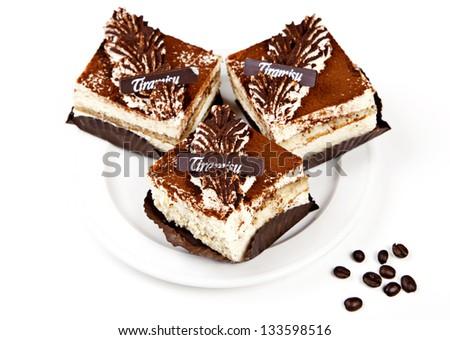 Tiramisu with coffee beans on white background - stock photo