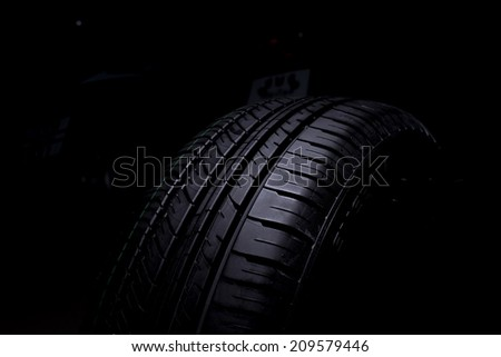 Tire Car on black background - stock photo