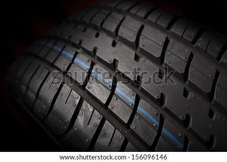 Tire isolated on black background - stock photo
