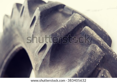 tire, maintenance, service and motor transport concept - close up of truck wheel tyre - stock photo