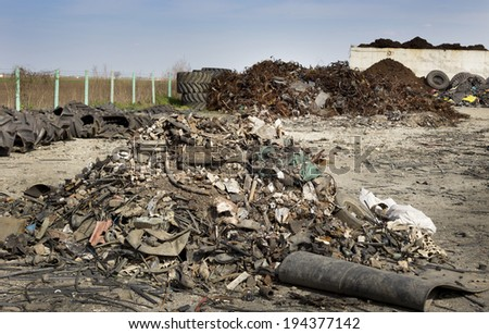 Tire parts and waste on few piles for recycling - stock photo