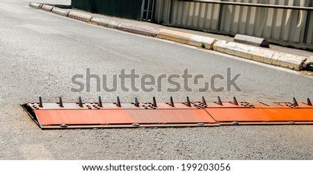 Tire piercing spikes standing upright and ready - stock photo