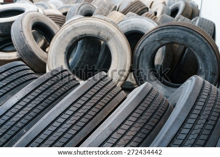 Tire stack background, Car ties selective focus - stock photo