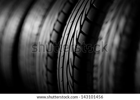 Tire stack, dark image good for background - stock photo