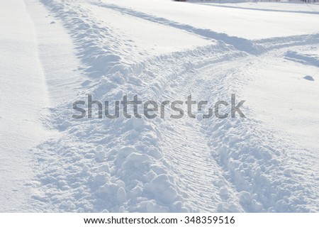Tire trace on a snow. snow background. - stock photo