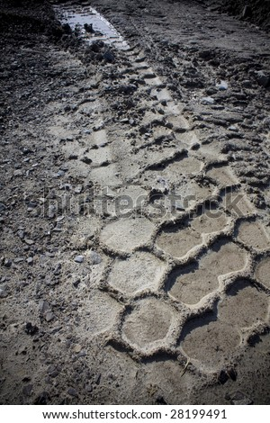 Tire Track in mud - stock photo