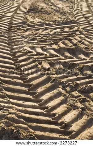 Tire-tracks in sand. - stock photo