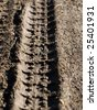 Tire tracks on ground - stock photo