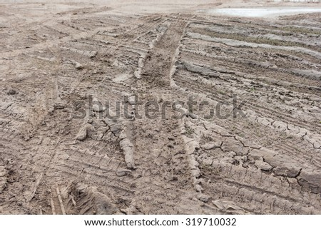Tire tracks on the ground. - stock photo