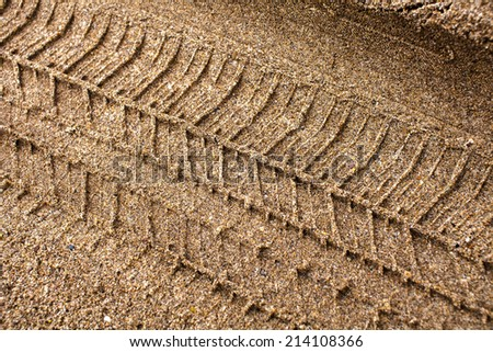Tire tracks on the sand - stock photo