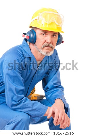 Tired adult worker has a rest sitting over white background - stock photo