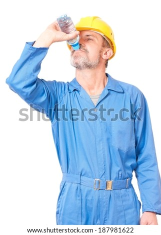 Tired adult worker with bottle of water over white background - stock photo