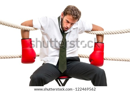 Tired  and beaten up businessman with boxing gloves isolated in white - stock photo