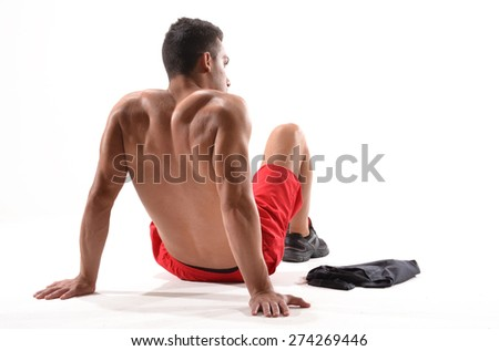 Tired and depressed sport man siting down and resting.Exhausted athletic man on white background. - stock photo