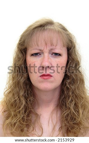 Tired and scowling woman - stock photo