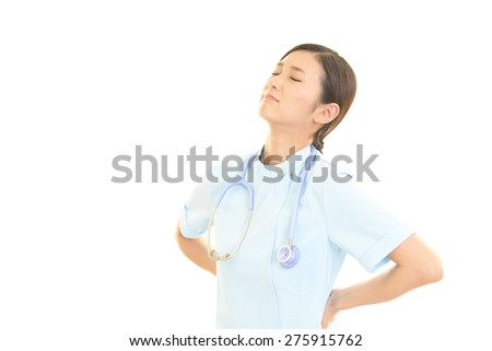 Tired Asian female nurse