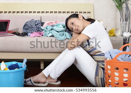 Tired Asian housewife
