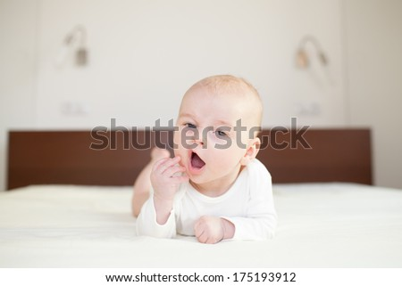 tired baby on sofa, Beautiful cute baby, expressive adorable, drowsy newborn - stock photo