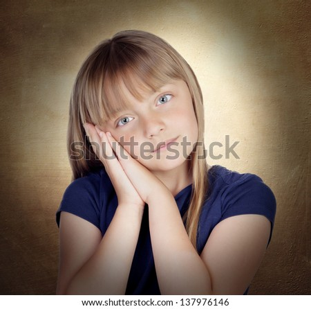 Tired blond girl on a over yellow background