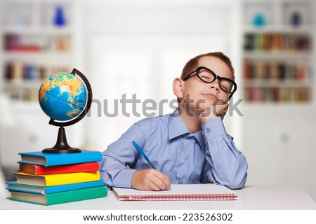 Tired Boy Sleeping on the School Desk on the white background - stock photo