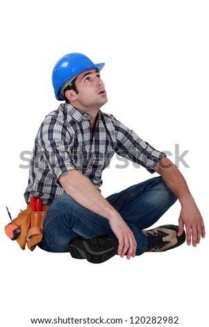 Tired builder taking well earned break - stock photo