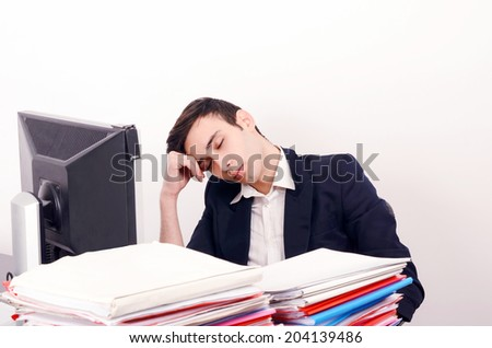 Tired business man sleeping at work. Exhausted worker sleeping at the desk. - stock photo