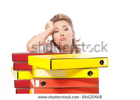 Tired business woman behind folder stack, too much work - stock photo