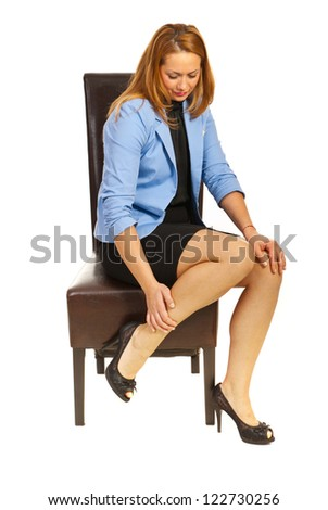 Tired business woman having legs pain isolated on white background - stock photo