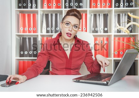 Tired business woman in glasses working with laptop  - stock photo