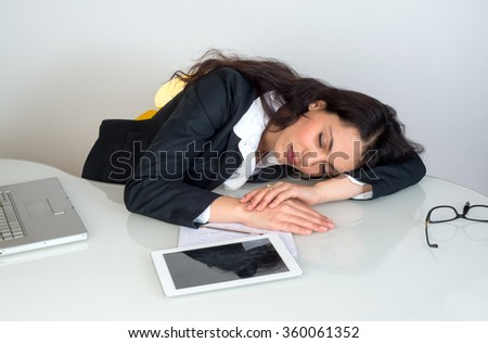 tired business woman sleeping at desk - stock photo