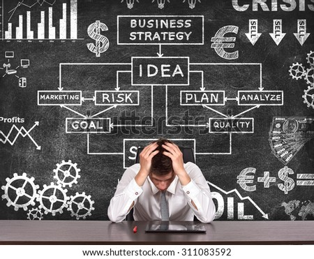 tired businessman and drawing  business concept on chalk board - stock photo