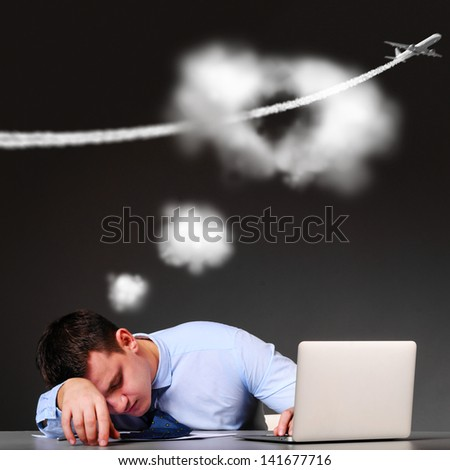 tired businessman is dreaming about vacation - stock photo