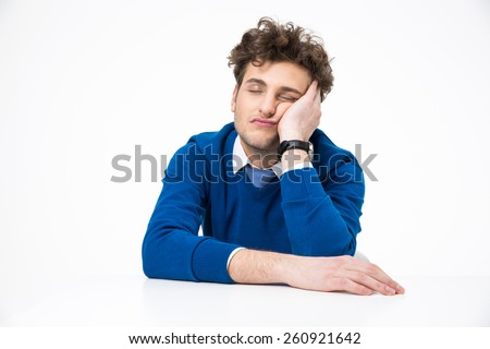 Tired businessman sleeping at the table over white background - stock photo