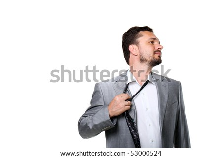 Tired businessman taking off his tie. Isolated on white. - stock photo