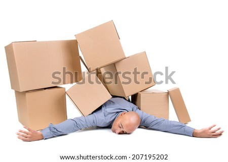 Tired businessman under a pile of cardboard boxes