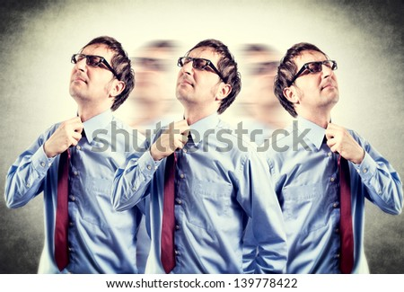 Tired businessman with problems taking of his tie in lomo effect - stock photo