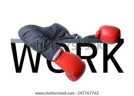 tired businessman with red boxing glove after fight with hard work - stock photo