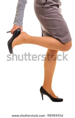 Tired businesswoman feet isolated on white - stock photo