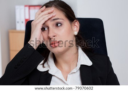 Tired businesswoman with headache/stress related problems - stock photo