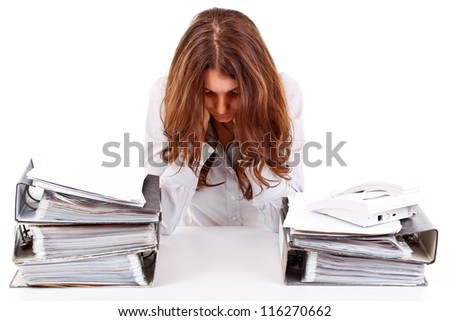 Tired businesswoman with unfinished paperwork - stock photo